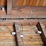 knob and tube electrical wiring on rafters in house