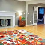 lovely painted room with bright rug