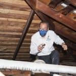 electrician checks for an attic fan
