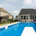Pool with diving board, basketbal goal and fountains