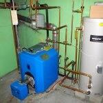 a blue boiler next to a gas tank