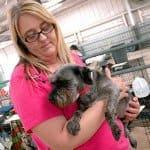 Dr. Kristi Scroggins holds a displaced dog