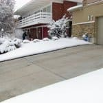 Ice melt can help keep your concrete driveway free of snow and ice in winter.