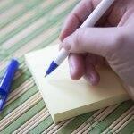 blue pen writing on yellow post it (Photo by Katelin Kinney)