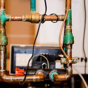 Plumbing pipe connected to water softener. (Photo by Photo by Summer Galyan)