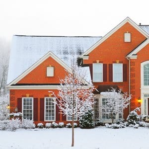 orange brick house in winter