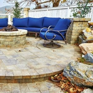 The right paver patio ideas can extend your home's living space. Consider how a custom seating area or fire pit could help to make the most of your patio area. (Photo courtesy of Go Pavers)