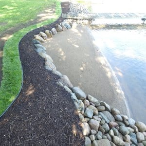 A lakeshore with landscaping.