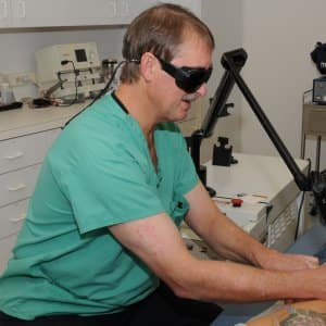 doctor performs laser tattoo removal