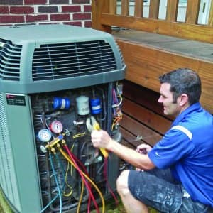 technician testing heat pump
