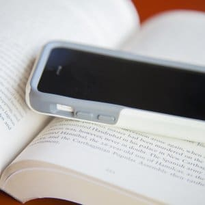 Cell phone mobile on open book pages
