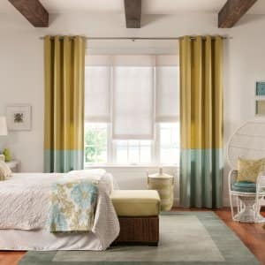 bedroom drapery with roller shades