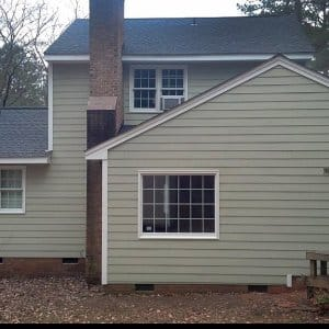the back of a house with fiber cement siding