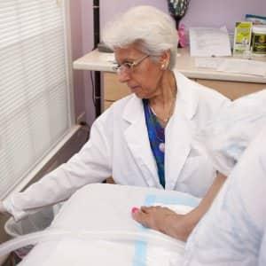 Dr. Sharda Sharma performing colon cleanse