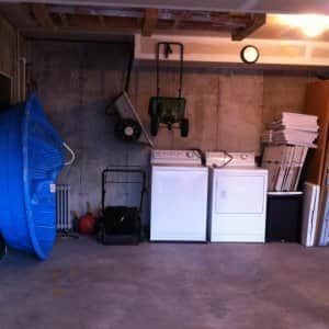 garage with washer and dryer (Photo by  Simplified Living Solutions )