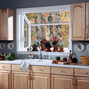 A garden window is a smaller type of bay window that provides display space in a kitchen. (Photo courtesy of WindowWorld.com)