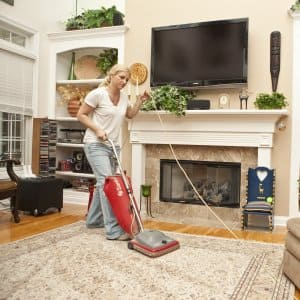 House cleaning employee vacuuming rug (Photo by Photo by Brandon Smith)