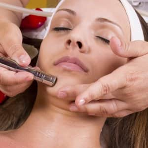 A woman receiving microdermabrasion treatment