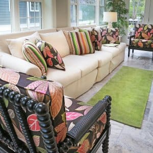 Attractive, uncluttered living room with couch and colorful chairs.  (Photo by Photo by Frank Espich  )