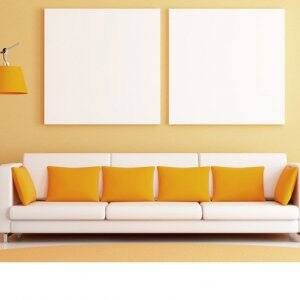 A Lezeti solar air conditioner in a room with white couch and orange pillows and lamp shade