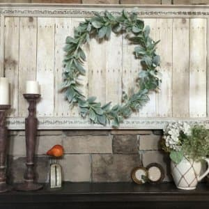 rustic farmhouse styled decor on fireplace mantel