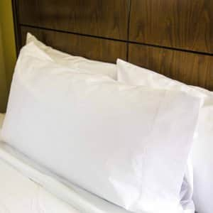 bed with pillows and sheets