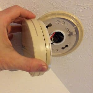 adjusting a hardwired smoke detector