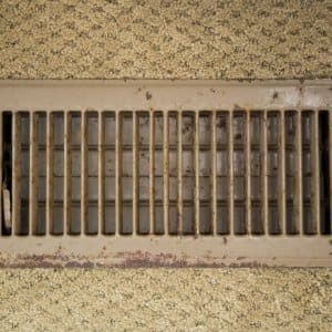 Air duct vent with carpet around it