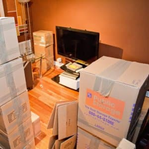 Boxes and a television being packed for a move