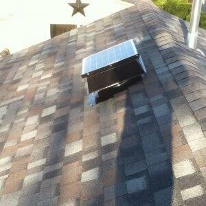 attic fan on asphalt shingle roof