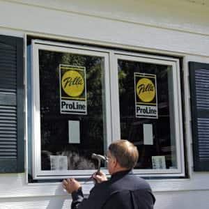 window, man installing window