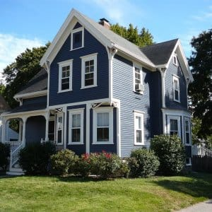 A blue house with white trim.