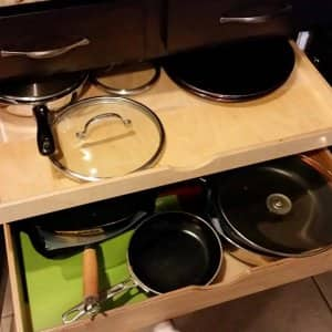Rollout shelves and kitchen drawers can help solve your kitchen storage problems.  (Photo courtesy of member Kory Stiles, Kissimmee, Fla.)