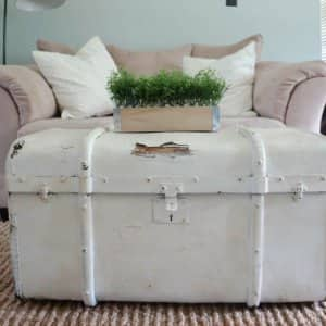 Using an old trunk as a coffee table will add some rustic charm to your family room. (Photo by Deb Foglia)