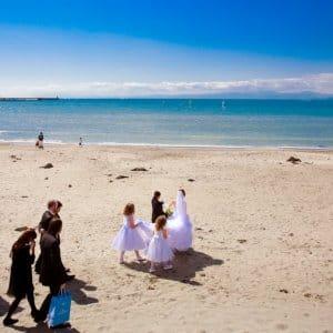 a wedding party on a beach