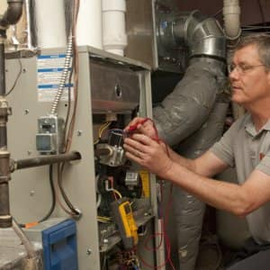 HVAC maintenance technician working on a unit