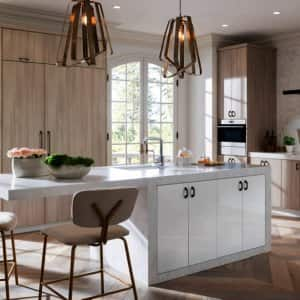 A kitchen island with cabinets and eating space