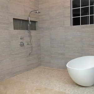 Accessible bathroom with stone tub and shower