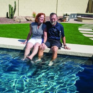 bev and barry baril poolside