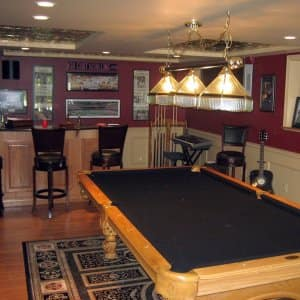 basement with wood floor and pool table