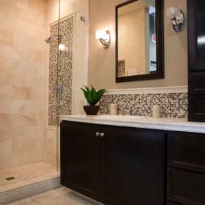 remodeled bathroom with walk-in shower, high-grade cabinets