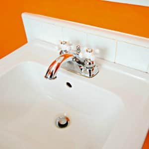 white sink attached to wall