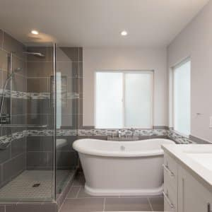 bathroom tile design on floor and shower with glass tile