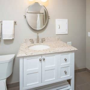 White bathroom vanity with granite countertop