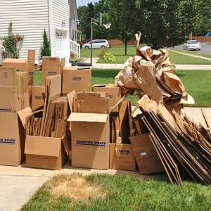 Empty moving boxes on a driveway