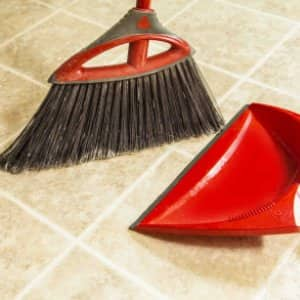 red broom and dust pan