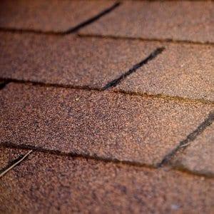 brown asphalt shingles up close