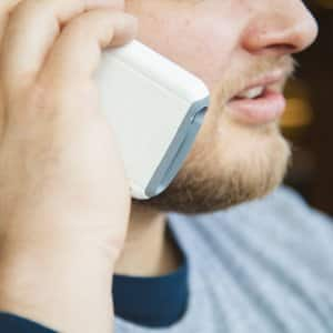 man on cell phone calling contractor references