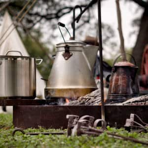 kettle and pot on campfire