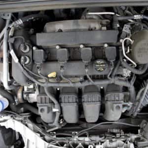 a car with the hood up exposing the engine